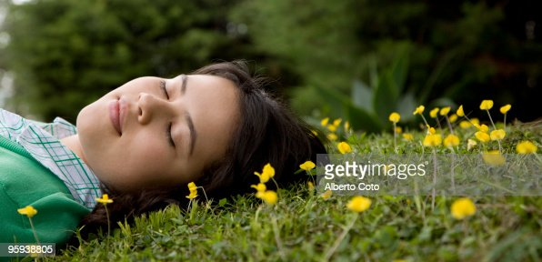 Latin girl lying in field