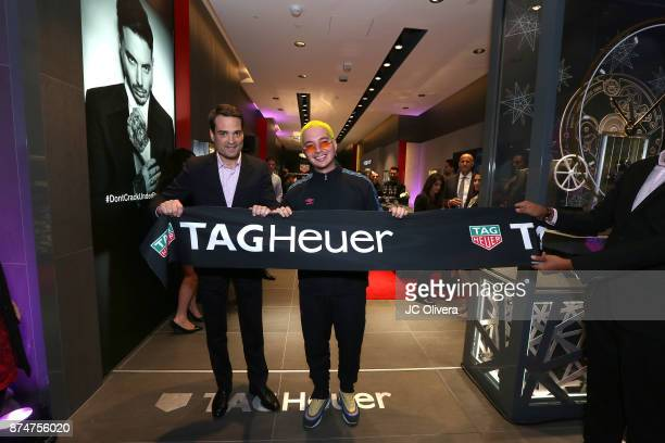 Latin Grammy Winner and TAG Heuer ambassador J Balvin and Kilian Muller TAG Heuer North America CEO attend the grand opening of the new TAG Heuer...