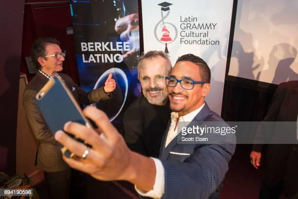 Latin GRAMMY Winner Miguel Bosé takes a selfie with Miguel Bosé Scholarship winner Ernesto Núñez at Berklee College of Music on June 9 2017 in Boston...