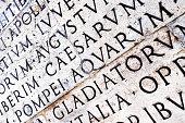 Latin inscription on Ara Pacis wall in Rome, Italy