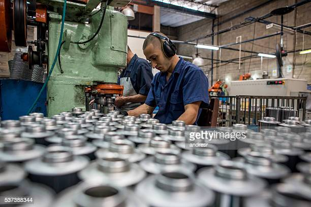 Latin man working at a metal factory