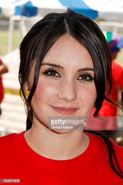 Latin popstar Dulce Maria joins the Lynwood Community KoolAid Kaboom to build kiddesigned playground at Lynwood City Park on August 29 2012 in...