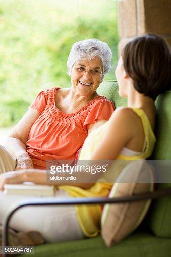 Latin senior talking with granddaughter