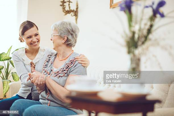 Latin social worker is visiting a senior woman