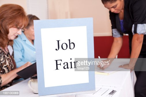 Latin woman at Job Fair registration table. Business people. Unemployment.