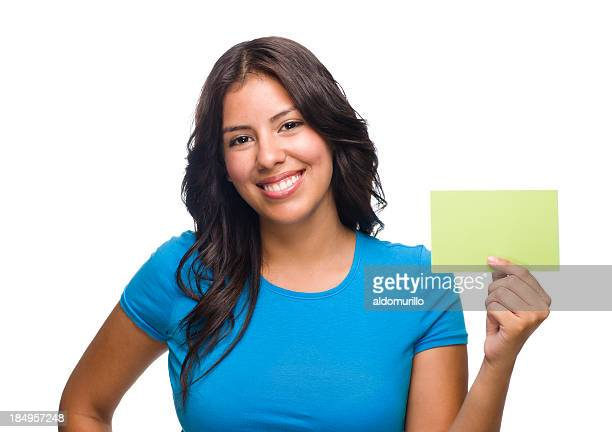 Latin woman holding a card