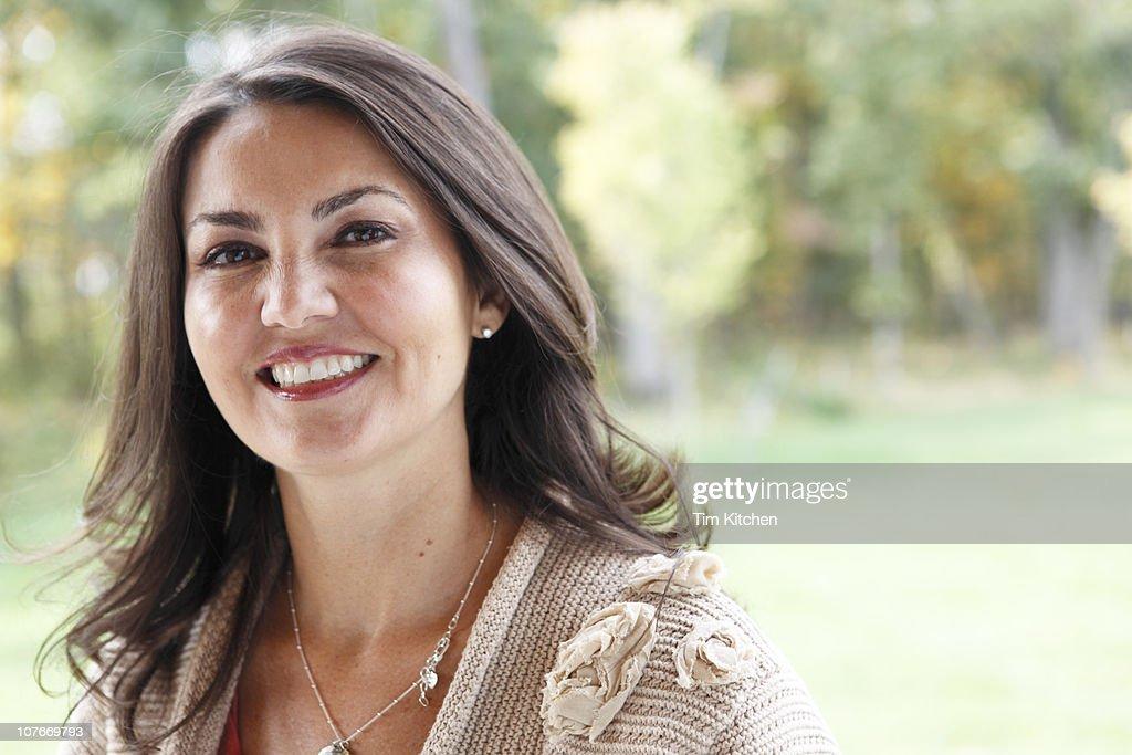 Latin woman smiling, portrait : Stock Photo