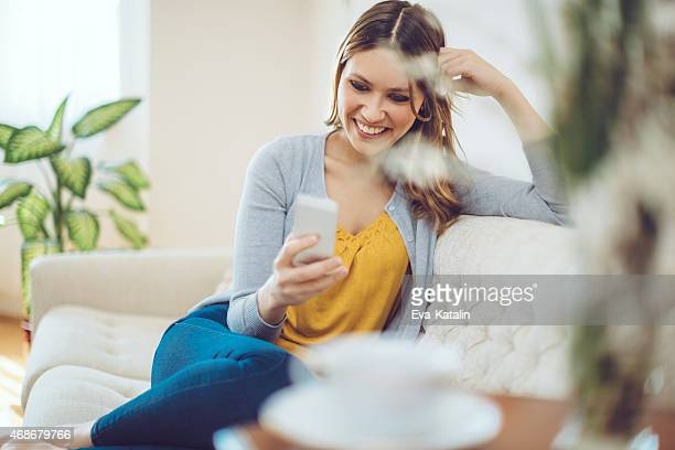 Latin woman texting at home