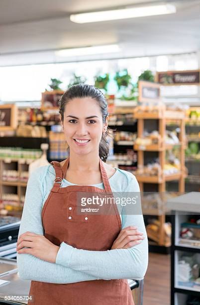 Latin woman working at a food market