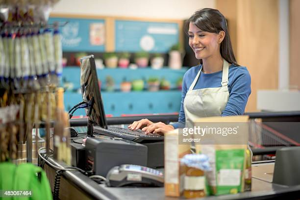 Latin woman working at a grocery store