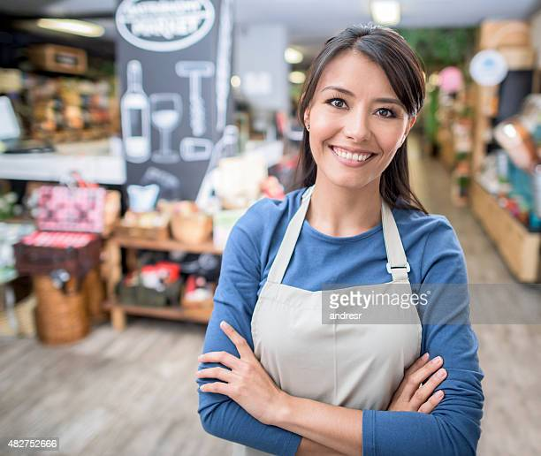 Latin woman working at a supermarket