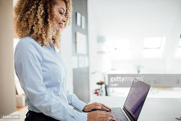 Latina Businesswoman Coding In Her Office