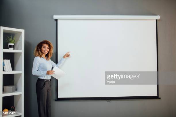 Latina Businesswoman Having Presentation In Her Office