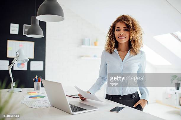 Latina Businesswoman Working In Her Office