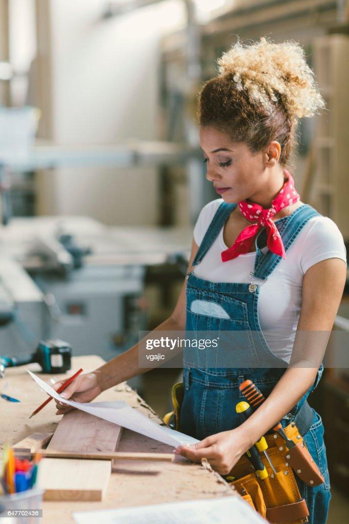 Latina Carpenter In Her Workshop : Stock Photo