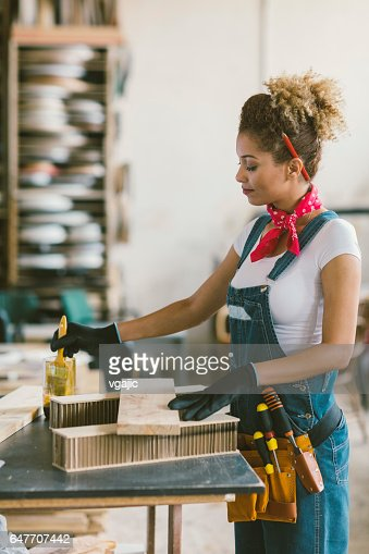 Latina Carpenter In Her Workshop : Bildbanksbilder