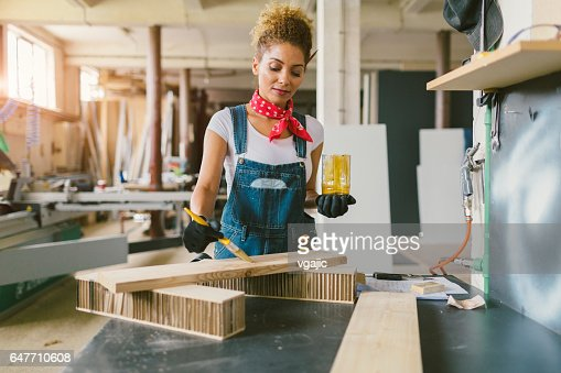 Latina Carpenter In Her Workshop : Stock Photo
