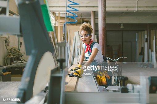 Latina Carpenter working on circular saw : Photo