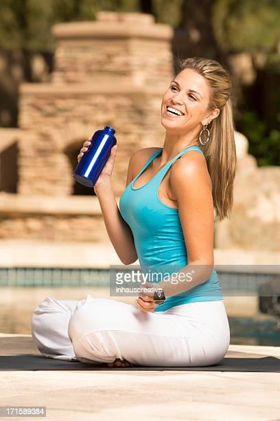 Latino Woman sitting on exercise mat