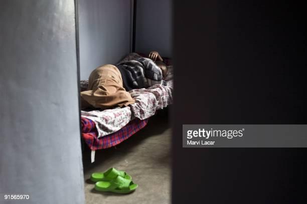 Lato Caroline Gilisho sobs after recalling her story inside a dormroom at the Tasaru Safehouse for Girls December 25 2006 in Narok Kenya The Tasaru...