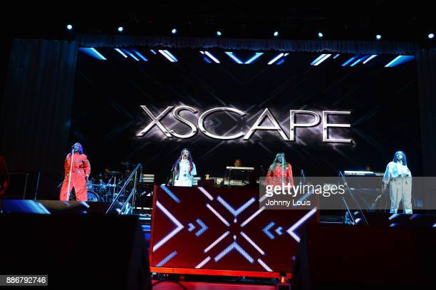 LaTocha Scott Tamika Scott Tameka Cottle and Kandi Burruss of Xscape perform during The Great Xscape tour at American Airlines Arena on December 5...