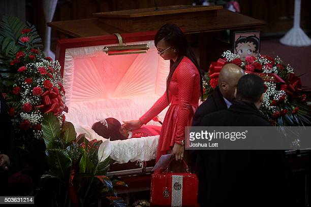 LaTonya Jones stands over her mother Bettie Jones during her funeral at New Mount Pilgrim Missionary Baptist Church January 6 2016 in Chicago...