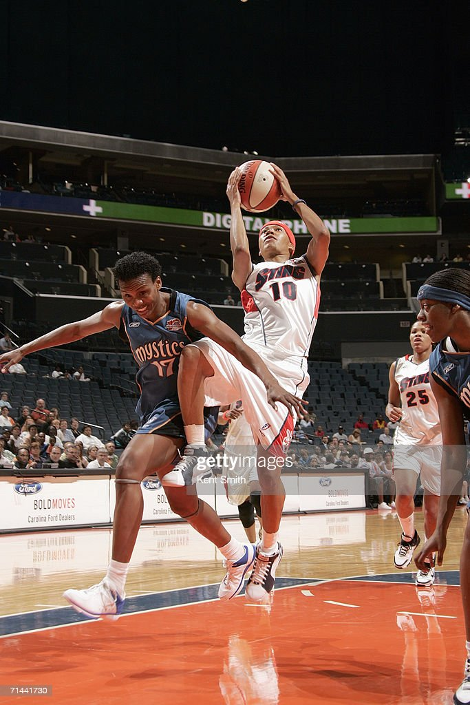 LaToya Bond of the Charlotte Sting makes a layup against Crystal Robinson of the Washington Mystics during the game on June 15 2006 at the Charlotte...