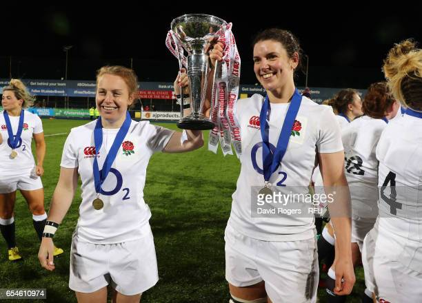 LaToya Mason and captain Sarah Hunter of England celebrate with the trophy after winning the Grand Slam during the Women's Six Nations match between...