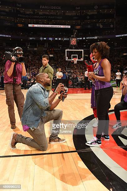 Latoya Robinson of the Raptors Dance Pak is proposed to during the Los Angeles Lakers and Toronto Raptors game on March 27 2015 at Verizon Center in...
