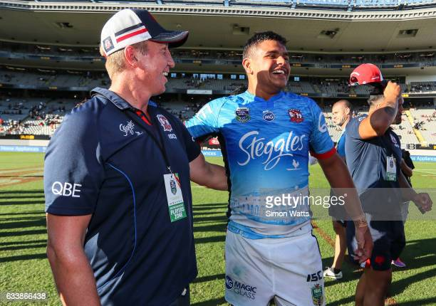 Latrell Mitchell and coach Trent Robinson of the Roosters celebrate winning the 2017 Auckland Nines final between The Sydney Roosters and Penrith...