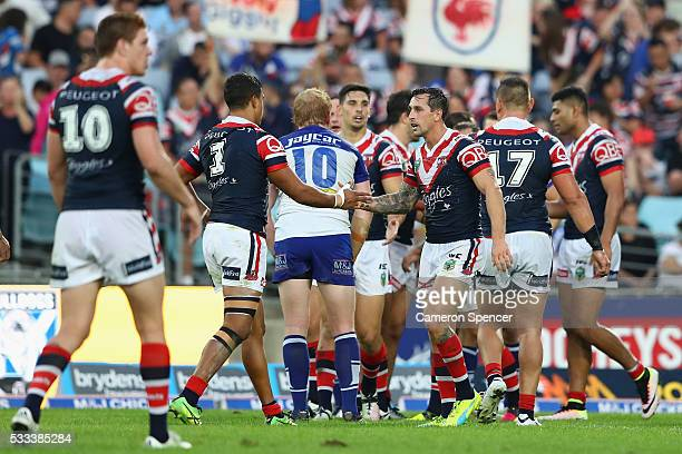 Latrell Mitchell of the Roosters and Mitchell Pearce of the Roosters celebrate a Roosters try during the round 11 NRL match between the Canterbury...