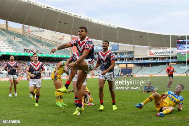 Latrell Mitchell of the Roosters celebrates after scoring a try during the round 10 NRL match between the Sydney Roosters and the Parramatta Eels at...