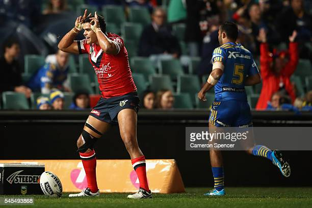 Latrell Mitchell of the Roosters celebrates scoring a try during the round 18 NRL match between the Parramatta Eels and the Sydney Roosters at Pirtek...