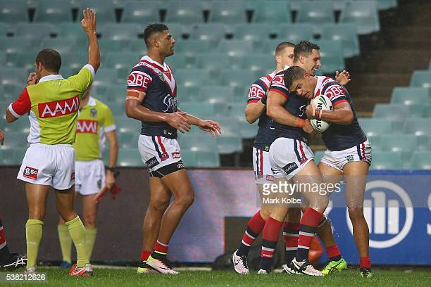 Latrell Mitchell of the Roosters celebrates with his team mates after scoring a try during the round 13 NRL match between the Sydney Roosters and the...
