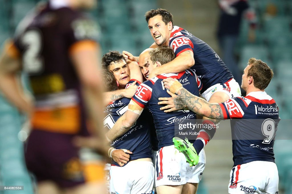Latrell Mitchell of the Roosters celebrates with his team mates after scoring a try during the NRL Qualifying Final match between the Sydney Roosters and the Brisbane Broncos at Allianz Stadium on September 8, 2017 in Sydney, Australia.