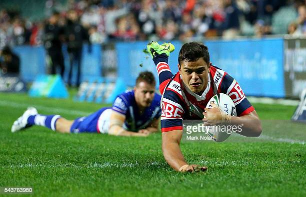 Latrell Mitchell of the Roosters dives to score a try during the round 17 NRL match between the Sydney Roosters and the Canterbury Bulldogs at...