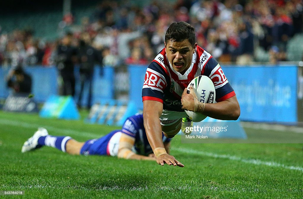 Latrell Mitchell of the Roosters dives to score a try during the round 17 NRL match between the Sydney Roosters and the Canterbury Bulldogs at Allianz Stadium on June 30, 2016 in Sydney, Australia.