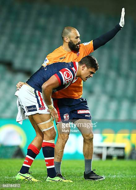 Latrell Mitchell of the Roosters is injured during the round 17 NRL match between the Sydney Roosters and the Canterbury Bulldogs at Allianz Stadium...
