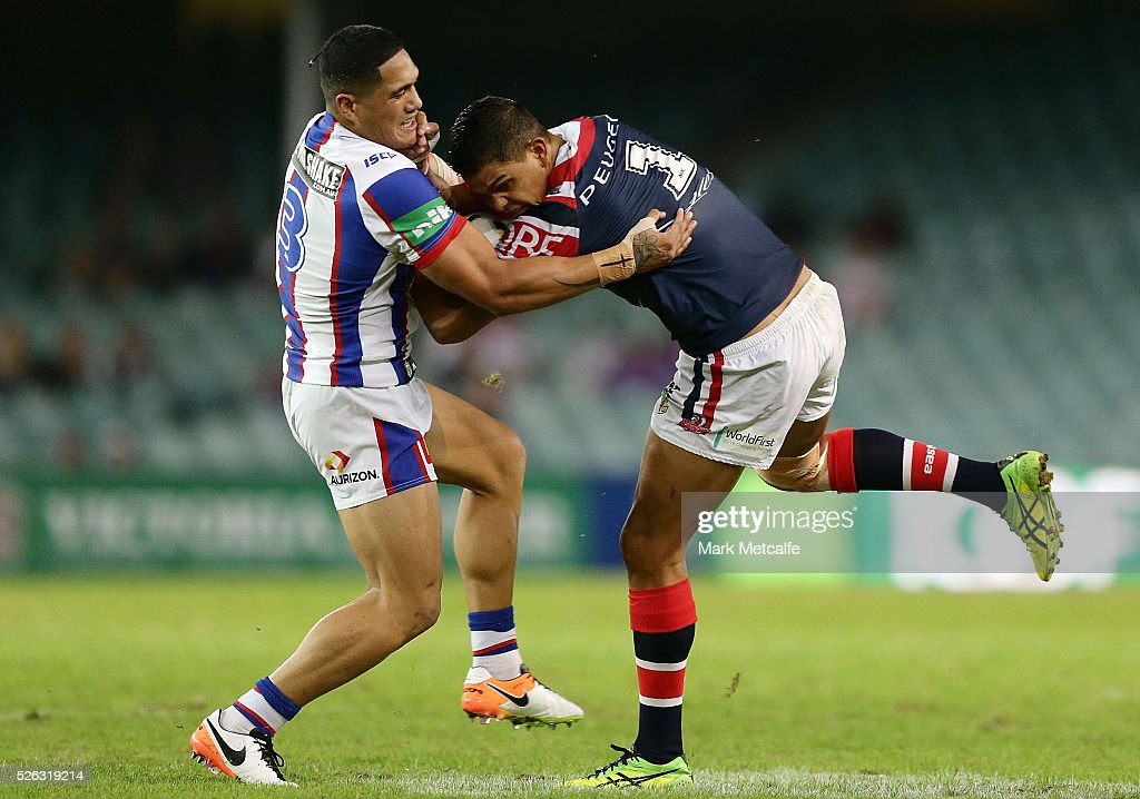 Latrell Mitchell of the Roosters is tackled by Sione Mata'utia of the Knights during the round nine NRL match between the Sydney Roosters and the Newcastle Knights at Allianz Stadium on April 30, 2016 in Sydney, Australia.