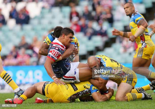 Latrell Mitchell of the Roosters is tackled during the round 10 NRL match between the Sydney Roosters and the Parramatta Eels at Allianz Stadium on...