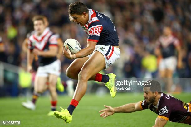 Latrell Mitchell of the Roosters jumps clear of the tackle as he breaks away to score a try during the NRL Qualifying Final match between the Sydney...