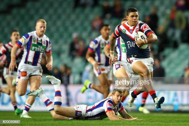Latrell Mitchell of the Roosters makes a break during the round 20 NRL match between the Sydney Roosters and the Newcastle Knights at Allianz Stadium...