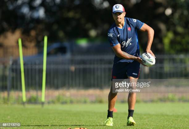 Latrell Mitchell of the Roosters passes during a Sydney Roosters NRL training session at Kippax Lake on May 10 2017 in Sydney Australia