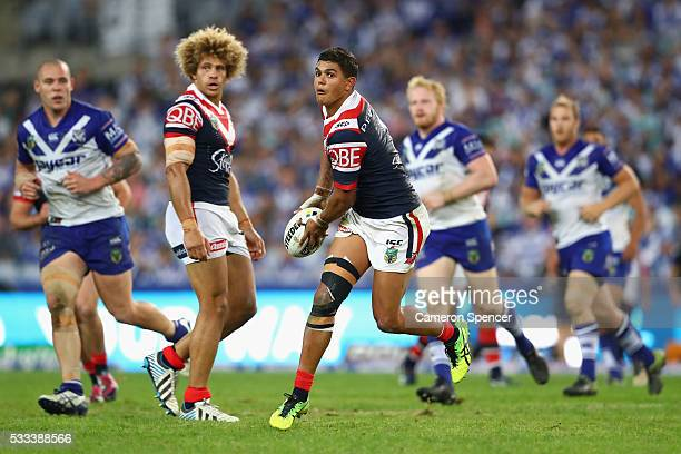 Latrell Mitchell of the Roosters runs the ball during the round 11 NRL match between the Canterbury Bulldogs and the Sydney Roosters at ANZ Stadium...