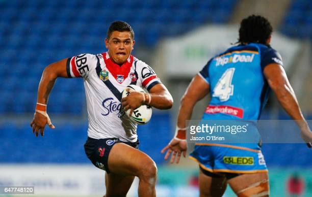 Latrell Mitchell of the Roosters runs with the ball during the round one NRL match between the Gold Coast Titans and the Sydney Roosters at Cbus...