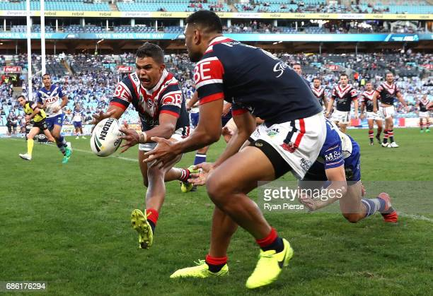 Latrell Mitchell of the Roosters scores a try during the round 11 NRL match between the Canterbury Bulldogs and the Sydney Roosters at ANZ Stadium on...