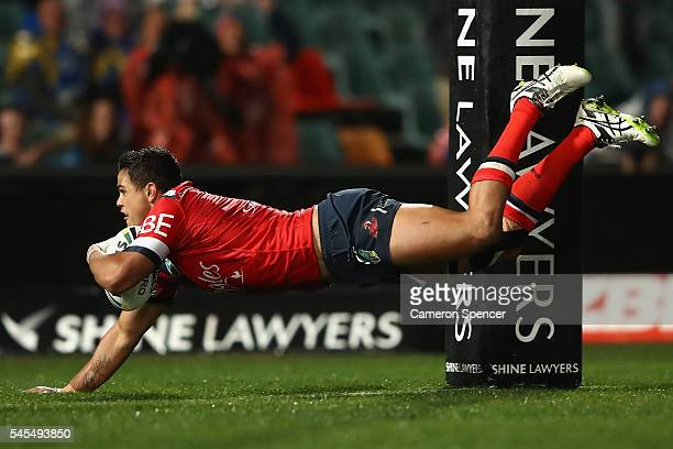 Latrell Mitchell of the Roosters scores a try during the round 18 NRL match between the Parramatta Eels and the Sydney Roosters at Pirtek Stadium on...