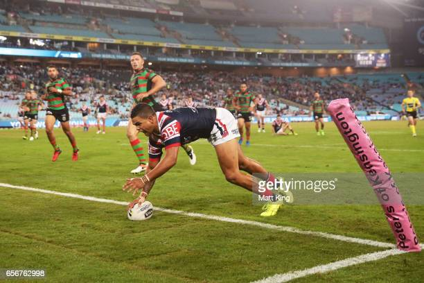 Latrell Mitchell of the Roosters scores a try during the round four NRL match between the South Sydney Rabbitohs and the Sydney Roosters at ANZ...