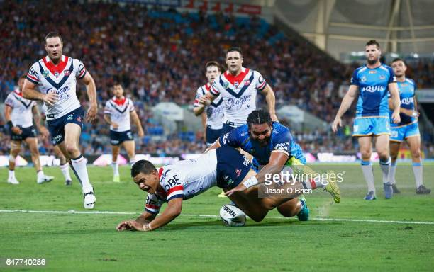Latrell Mitchell of the Roosters scores a try during the round one NRL match between the Gold Coast Titans and the Sydney Roosters at Cbus Super...