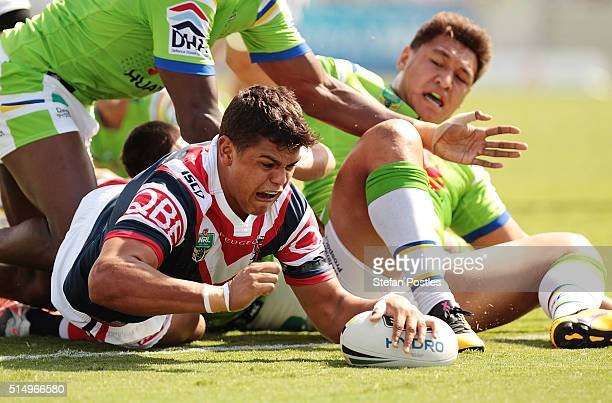 Latrell Mitchell of the Roosters scores a try during the round two NRL match between the Canberra Raiders and the Sydney Roosters at GIO Stadium on...